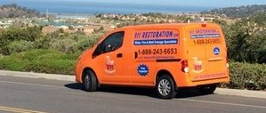 Commercial Property Damage Restoration Van Driving To Job Location